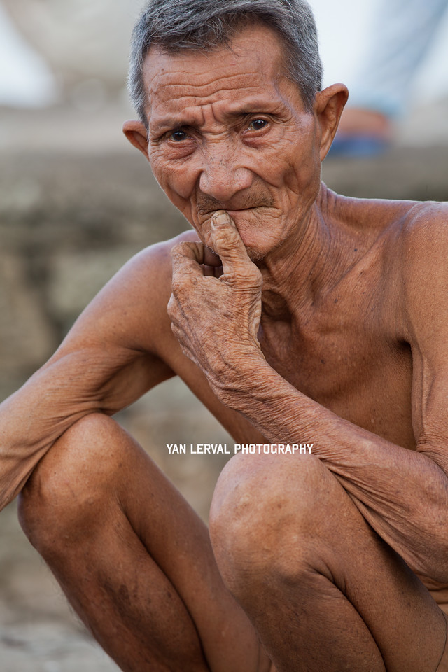 Old man sitting, Thanh An Island near Vung Tau, Vietnam