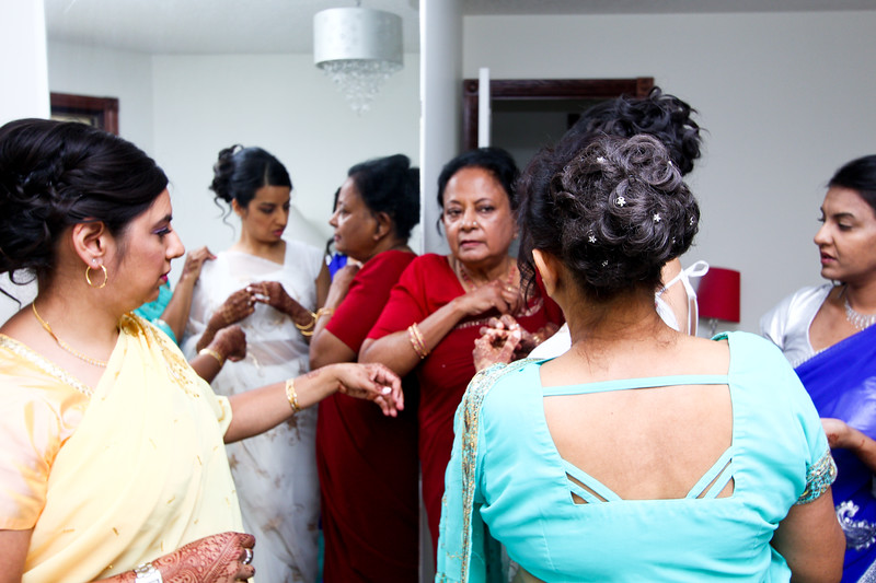 Every detail of her outfit is considered. We spent over 45 minutes covering the bride getting ready. She was really involved in co-ordinating the 4 ladies fixing her sari!