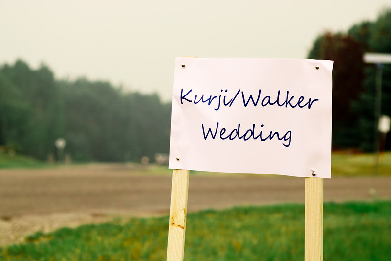 This sign was posted strategically at the nearby intersection. We captured this image early in the morning as we were heading towards the ceremony location. You can see the smokey Calgary sky on Aug 18, 2018.