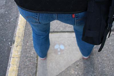 Jo's Butt.  Standing over the sidewalk skull.
