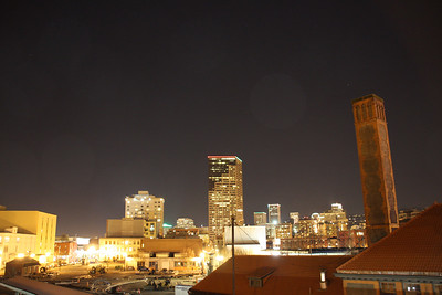 A night shot of the city from the Portland Union Station railroad pedestrian bridge.
