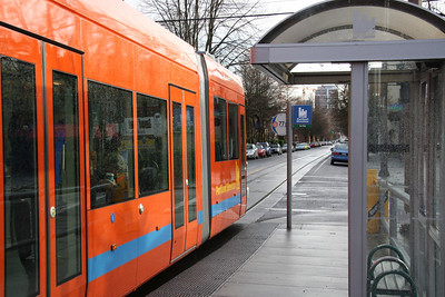 The orange side of the Portland Streetcar at Lovejoy and 21st.  A nice normal nasty rainy day in Portland, I love it.  Taken early Saturday morning at about 9am.