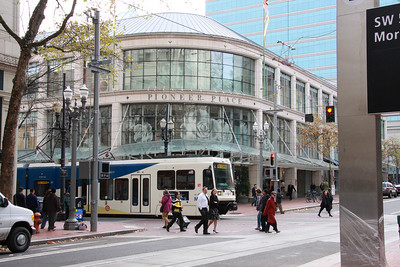 MAX Yellow Line LRV pulling away from Pioneer Place Mall in downtown Portland.