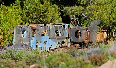Abandoned mining engine and wagons outside the Tunél Jose Maestroe