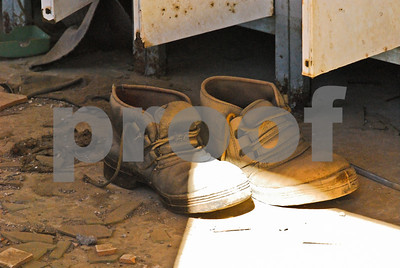 Abandoned shoes in the locker room at the Peñarroya site at Portmán, Murcia