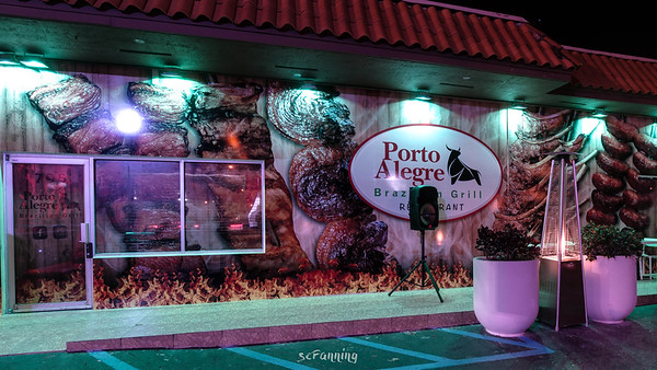 Exterior view showcasing the charming nighttime lighting and decorating of the facade of the Porto Alegre Brazilian Grill in Hialeah Fl.