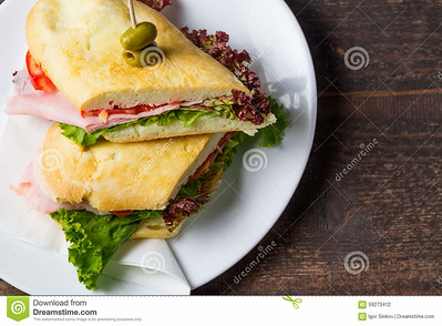 http://www.dreamstime.com/stock-photography-overhead-view-ham-sandwich-delicious-lettuce-tomato-image59273412