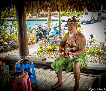 Ethnic old man is singing in Vaitape, Bora Bora, French Polynesia, April 2017
