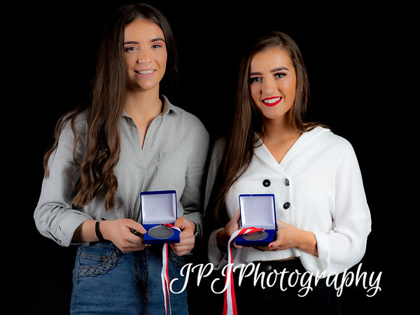 Derry City Women's Leah McDaid and Bronagh McGuiness receive their awards at the end of the 2018 season.