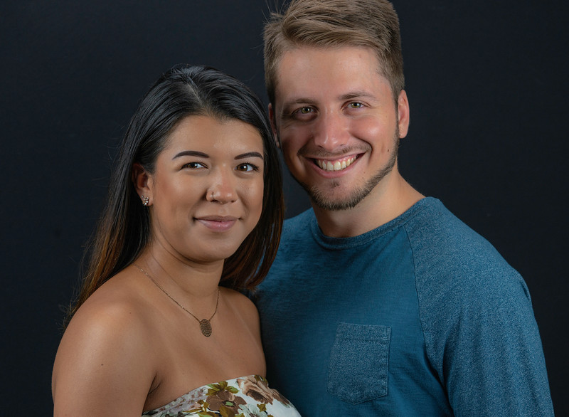Couples headshots over black