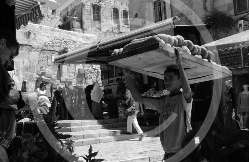 A boy delivers fresh baked bread in Jerusalem's old city in the Muslim quarters.