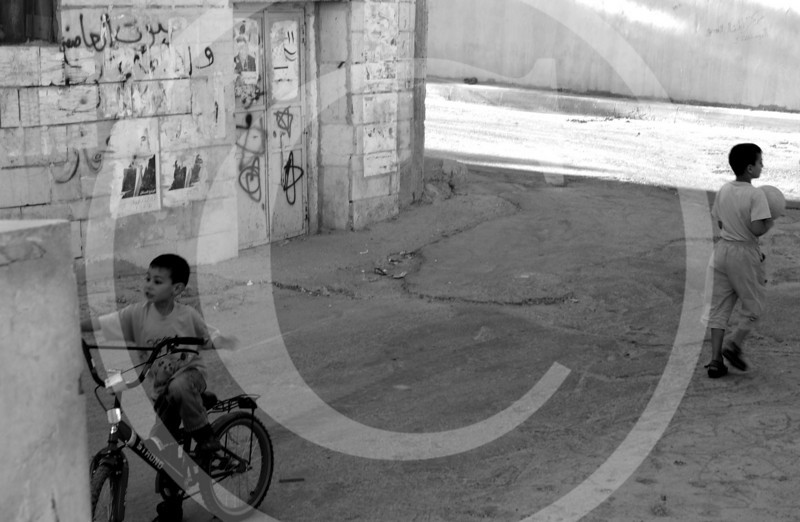 Two boys playing in Idyah Refugee Camp, Bethlehem, West Bank.