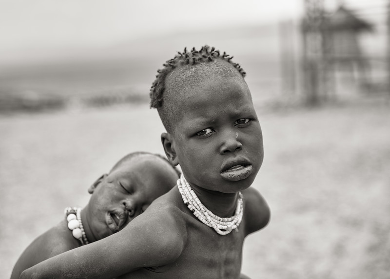 Boy Carrying Sleeping Baby, Ethiopia