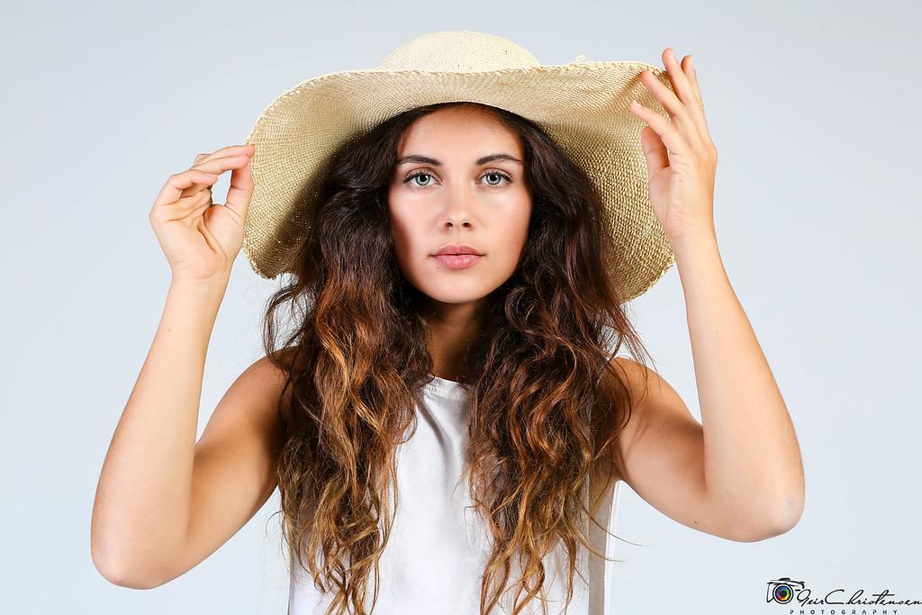 Sabi holding hat