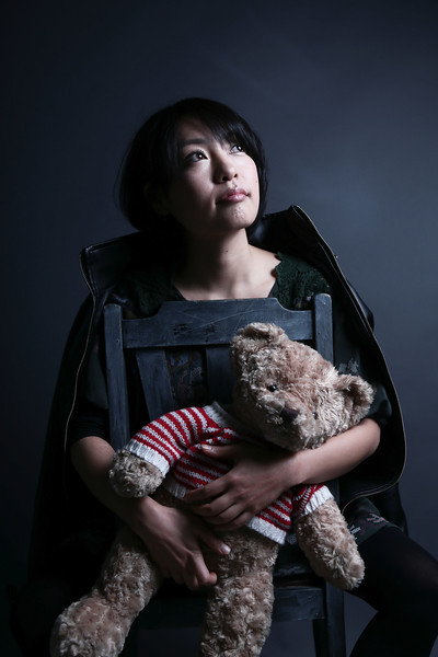 Japanese girl holding a bear