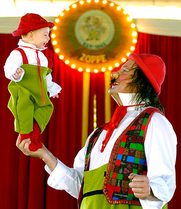 Giovanni Zoppe, Nino the Clown, holds son, Giovanni Julien Veneto Zoppe, 6 mos., inside their circus tent set up at Freedom Ridge Park in Ridgeland for the KidFest this weekend. The Zoppe's will be performing a traditional style circus at the event.