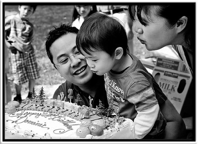 With a Little Help  Dominic finally succeeds in blowing out the candle on his train-themed 2nd-birthday cake.  Cuesta Park Mountain View, California  12-SEP-2010