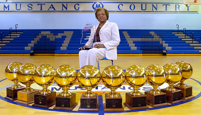 Murrah Lady Mustangs basketball coach Anna Jackson displays the trophies she has won over her years at the school.