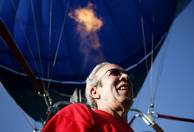 Gary Waldman of Cushing, Iowa helps finish setting up 'Serena's Song' hot air balloon at the Casey Popcorn Festival in Casey, Illinois on Saturday, August 30, 2008. Waldman first got the idea to create a handicap accessible hot air balloon when his daughter, who suffers from Cerebral Palsy, vocalized for the first time after a ride in a hot air balloon.  Since that day in 1985, Waldman has been on a self imposed mission to bring joy to people with disabilities by offering them the unique opportunity to ride in a hot air balloon. 'Serena's Song' is the first handicap accessible wheel chair to be approved by the Federal Aviation Administration. (Jay Grabiec/Staff Photographer)