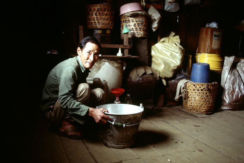 Taiwan, Farm near Ali Shan, The Plum Wine Farmer pouring wine for a visitor