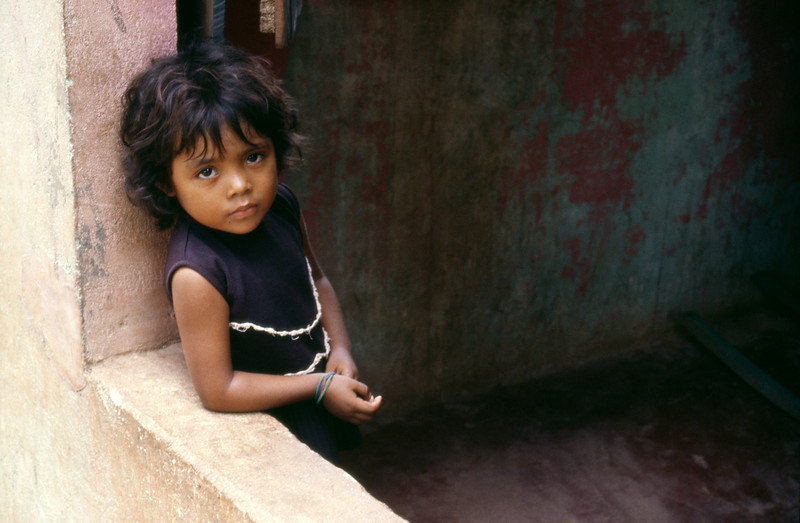 Mexico, Tabasco, Villahermosa, A young girl watching at her window