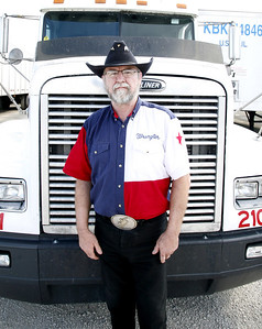 Robert Kingery, Greenup, Illinois check his semi-truck before making a trip to deliver US mail at Midwest Transport Inc. in Greenup on Monday, June 30, 2008. (Jay Grabiec/Staff Photographer)