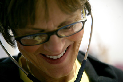 Renee Ringuette listens to a patient's pulse before a METS rehabilitation session at Sarah Bush-Lincoln Health Center in Mattoon, Illinois on Wednesday, February 11, 2009. (Jay Grabiec)