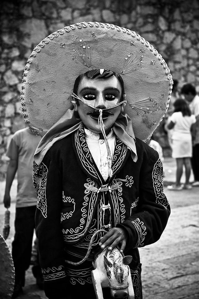 A boy in costume in Guanajuato, Mexico during the Miner's festival.