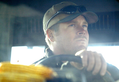 Nate Ralston transfers corn from the grain wagon to a semi truck at some of the Ralston's farm land located on IL route 130 about ten miles south of Charleston, Illinois on Saturday, November 1, 2008. (Jay Grabiec/Staff Photographer)