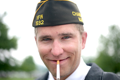 Eric lights up a cigarette after a Memorial Day service at Roselawn Cemetary in Charleston, Illinois on May 25, 2009. (Jay Grabiec)