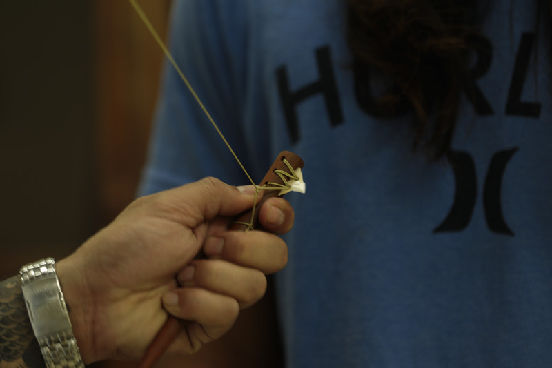 Instruction on Lashing on Niho ʻOki ( Cutting Implement with Shark Tooth ) -  Kumu Jordan Souza with student Duke Quitevis