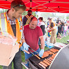 Tumbler Ridge Public Works members Justin Zimmer and XXX prepare hot dogs for members of the public at the Public Works Week celebration June 2 in Tumbler Ridge.