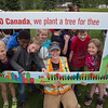 Public Works member Marcie Doonan poses with a group of kids after the tree planting celebration in Tumbler Ridge.