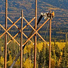 A pair of workers work on the transmission lines for the Quality Wind Project.