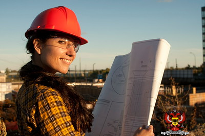 Woman construction worker with helmet