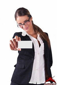 Brownhead Woman in Black Suit with Glasses Holding a Businesscard
