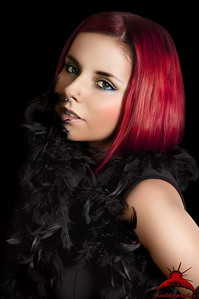 Gorgeous Young Glamour Redhead with Feather Scarf