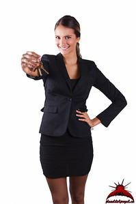 Beautiful Young Executive Lady In Black Holding Keys