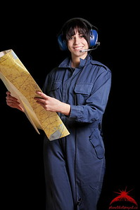 Woman Pilot Holding a Map Smiling