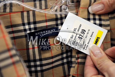 3/2/2011 Mike Orazzi | Staff A Burberry shirt on the rack at the Savers in the Bristol Plaza.
