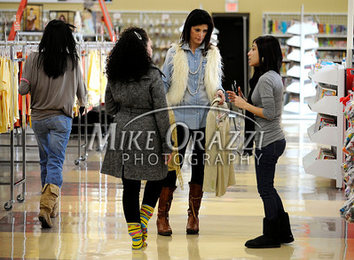 3/2/2011 Mike Orazzi | Staff Fashion expert Debbie Wright (center) talks with Rosie Rivera (left) and Tiffany Serrano while preparing for the fashion show at the Savers as part of the store's grand opening in the Bristol Plaza on Wednesday night.