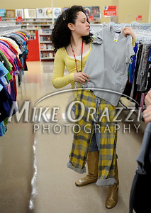 3/2/2011 Mike Orazzi | Staff Rosie Rivera looks for outfits while preparing for the fashion show at the Savers as part of the store's grand opening in the Bristol Plaza on Wednesday night.