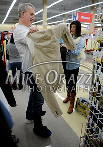 3/2/2011 Mike Orazzi | Staff Radio personality Damon Scott tries on an outfit picked out by fashion expert Debbie Wright while preparing for the fashion show at the Savers as part of the store's grand opening in the Bristol Plaza on Wednesday night.