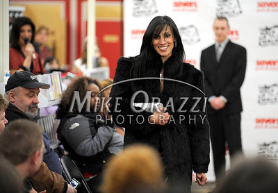 3/2/2011 Mike Orazzi | Staff  Maribel Garcia of New Britain during the fashion show at the Savers as part of the store's grand opening in the Bristol Plaza on Wednesday night.