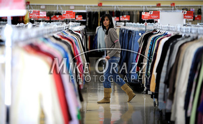 3/2/2011 Mike Orazzi | Staff Maribel Garcia while preparing for the fashion show at the Savers as part of the store's grand opening in the Bristol Plaza on Wednesday night.