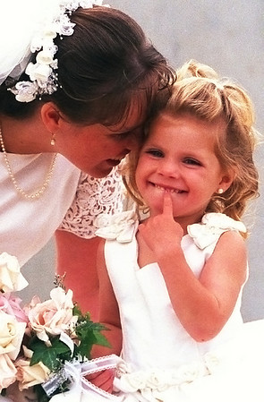 The Wedding for Social Life. Shelly_Anne Minnie whispers to flower girl Cassidy Piney, 3.  Photo by Patrick Doyle.