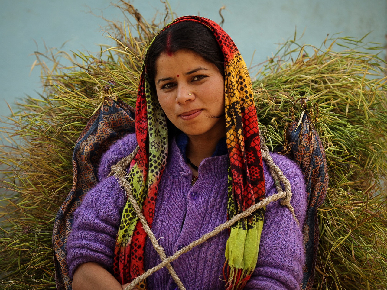 Young Woman Carrying Grasses