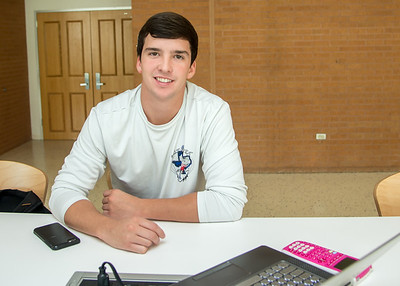 Student Luke Condron studies for physics II in the Tejas Lounge area.