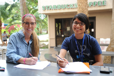 Kelly Rojas(left) and Adriel Bruce, study along side each other for their Genetics Homework.