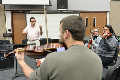 Dr. Jose Flores instructs his students on proper technique, during the String Technique class.